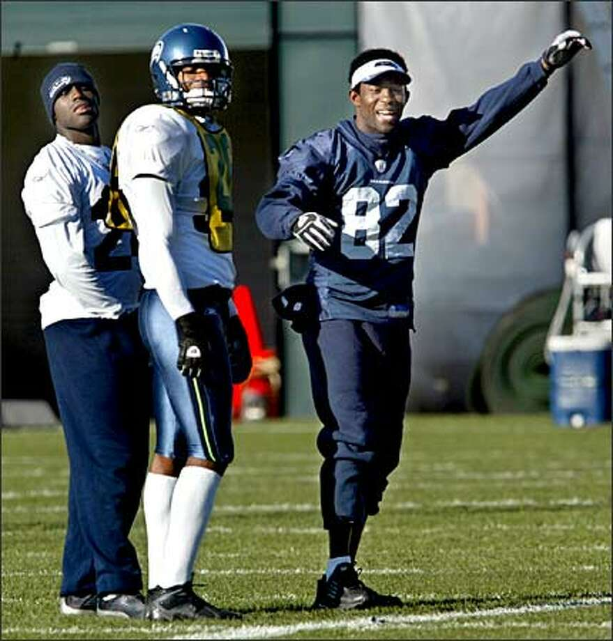 Seahawks wide receiver Darrell Jackson, who suffered a concussion and seizure after a helmet-to-helmet hit on Sunday, cheers for his teammates during practice in Kirkland. Photo: Renee C. Byer/Seattle Post-Intelligencer