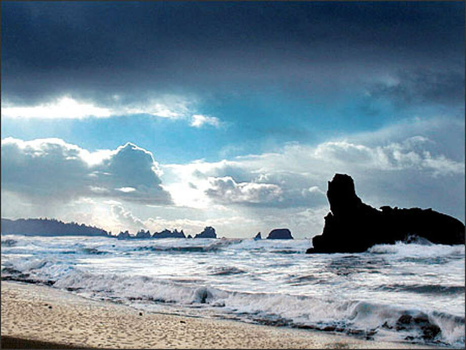 A view of Olympic National Park's Shi Shi beach during a winter storm as the clouds break up. Such scenes are common along this stretch of pristine coastline. Photo: Jeff Larsen/Seattle Post-Intelligencer