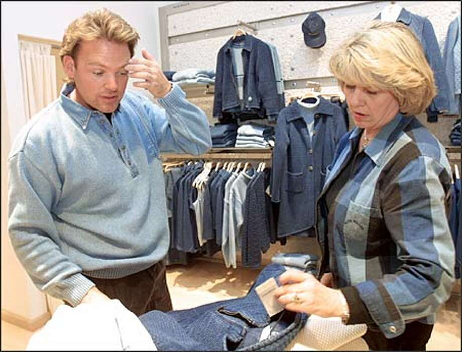 Randy Altig gets help from salesclerk Barbara Bartak as he looks over some clothes that he is buying for his sister at Blue Willi's in Bellevue Square. Photo: Phil H. Webber/Seattle Post-Intelligencer