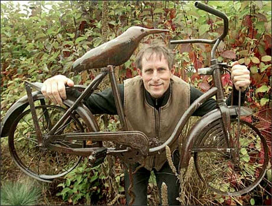"""Christopher Pauley's metal pieces take on all sorts of whimsical shapes and sizes, such as his """"Birdcycle."""" Photo: Grant M. Haller/Seattle Post-Intelligencer"""