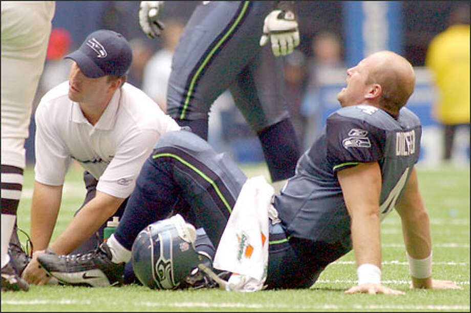 Trent Dilfer will be on crutches for a while, but he plans to refine his diet and design an exercise program to keep the rest of his body in shape. Photo: / Associated Press