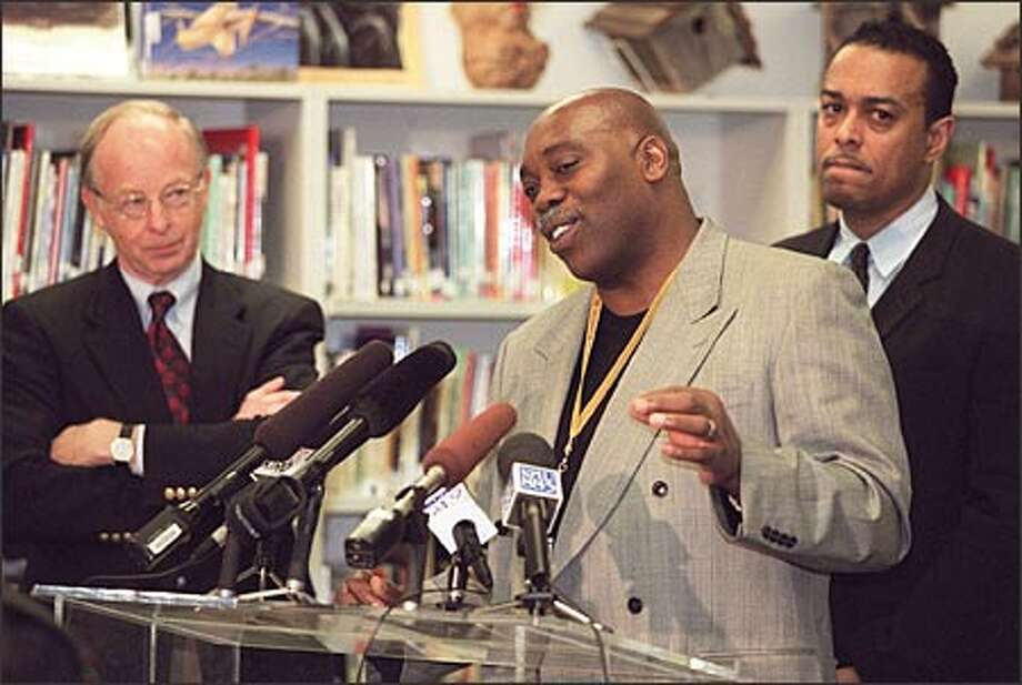 Don Neilsen, former School Board president, at left, Ben Wright, Thurgood Marshall Elementary School principal, and James Kelly, at right, president of the Urban League of Metropolitan Seattle, speak in support of Olchefske. Photo: Loren Callahan/Seattle Post-Intelligencer