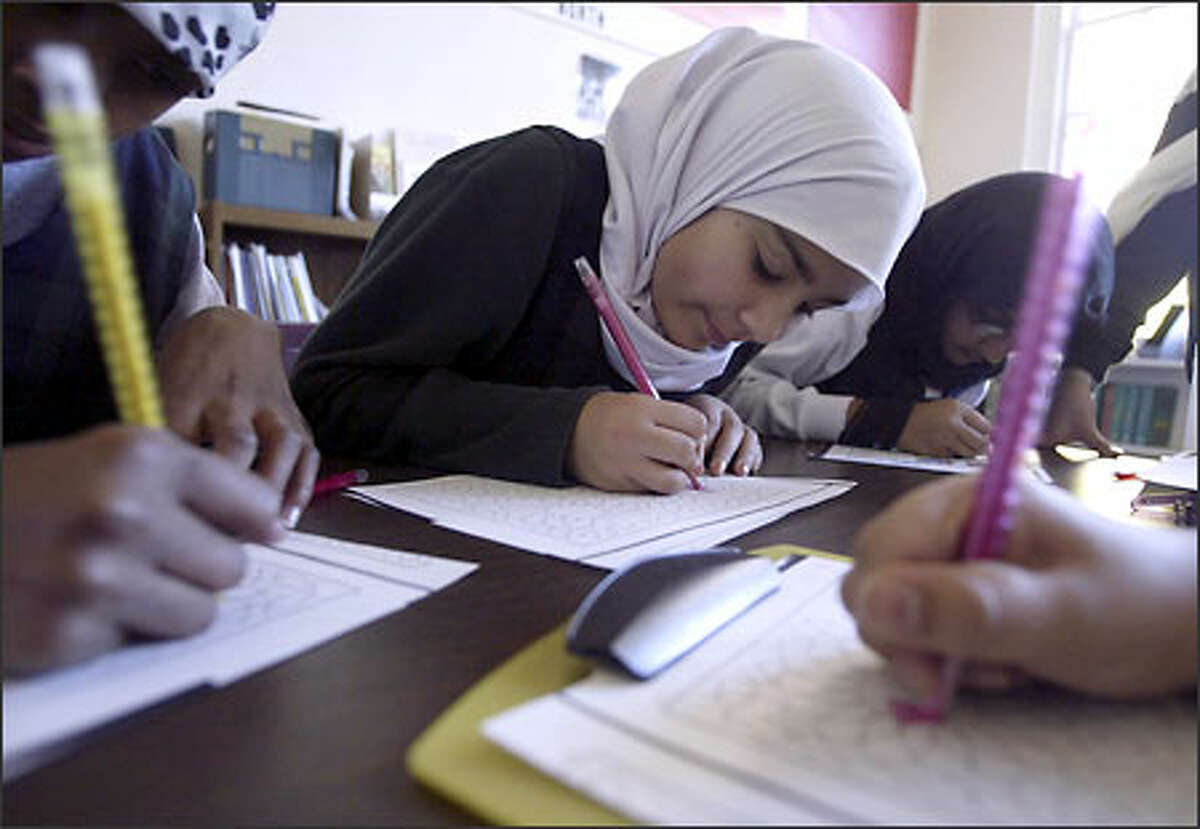 Tasneem Junejo, a student at Seattle's Islamic School, works on an art project in class on Friday. Muslims in the area have grown from three families in the 1960s to about 30,000 people today.