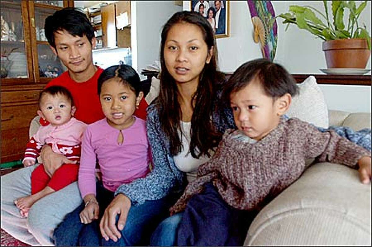 Newly educated Chomrong Sok is shown with her three children, from left, 7-month-old Tetiana Mountha, 6-year-old-Mylin Srouch and 2-year-old Atreu Mountha. Also shown is Trez Mountha, the father of Atreu and Tetiana.
