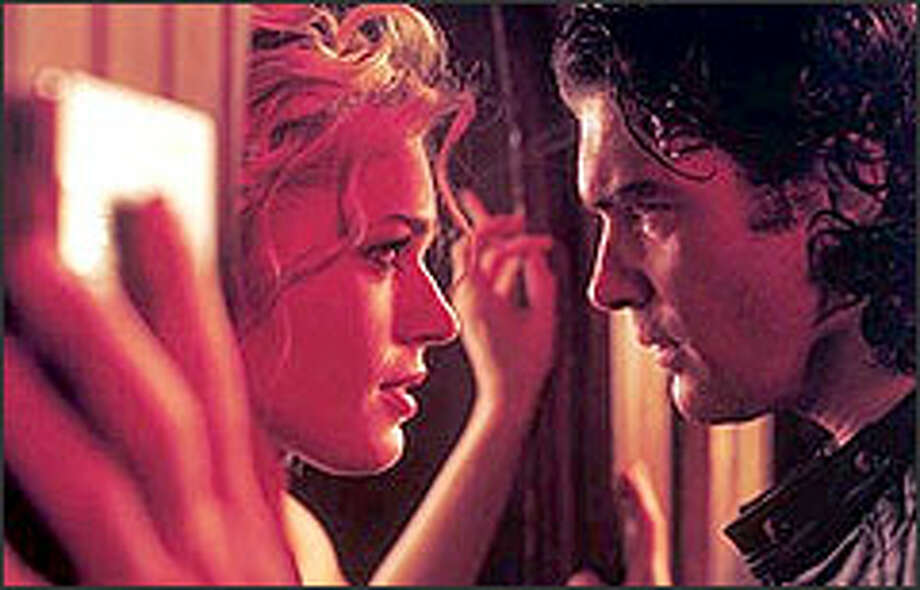 Con artist Laure's (Rebecca Romijn-Stamos) carefully fabricated world is shattered by one click of Nicholas' (Antonio Banderas) shutter. Photo: ETIENNE GEORGE