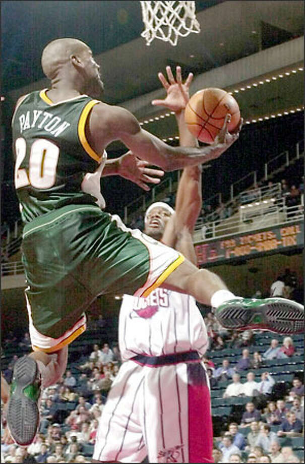 Gary Payton goes up for a layin against Houston's Juaquin Hawkins. Payton moved into 11th on the NBA's career assists list, passing Bob Cousy. Photo: / Associated Press
