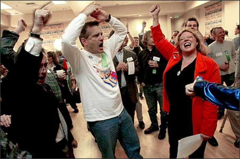 Monorail supporter Tom Tilson and campaign co-chair Cindi Lawx try to keep spirits soaring at Monorail headquarters despite a poor showing in early returns. Photo: Mike Urban/Seattle Post-Intelligencer