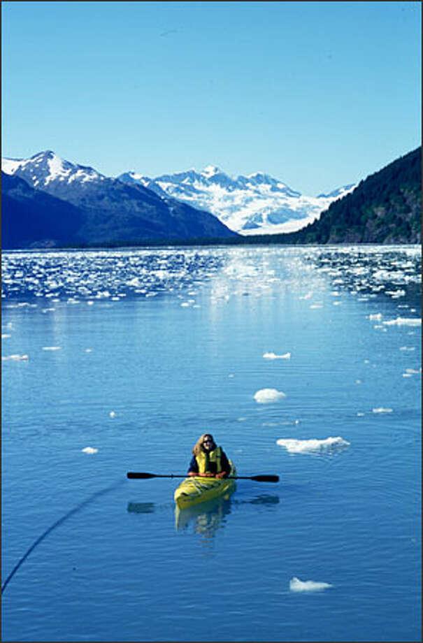 Bellamy Pailthorp, of KPLU radio in Tacoma, kayaks in Harriman Fjord. Photo: Joel Connelly/Seattle Post-Intelligencer