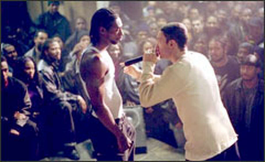 Eminem brings a burning intensity to his role as Jimmy, pictured here in a showdown with rival rapper, Lotto (Nashawn Breedlove).