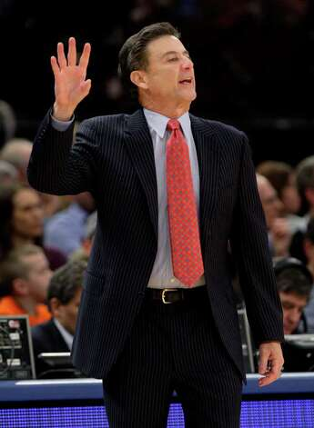 Louisville head coach Rick Pitino calls out to his team during the first half of an NCAA college basketball game against Connecticut at the Big East championship, Saturday, March 12, 2011, in New York. (AP Photo/Frank Franklin II) Photo: AP