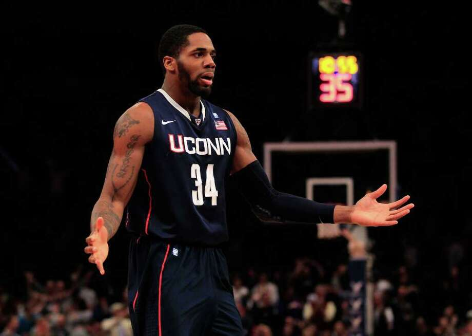 NEW YORK, NY - MARCH 12: Alex Oriakhi #34 of the Connecticut Huskies reacts after a play against the Louisville Cardinals during the championship of the 2011 Big East Men's Basketball Tournament presented by American Eagle Outfitters at Madison Square Garden on March 12, 2011 in New York City.  (Photo by Chris Trotman/Getty Images) *** Local Caption *** Alex Oriakhi Photo: Chris Trotman, Getty Images / 2011 Getty Images