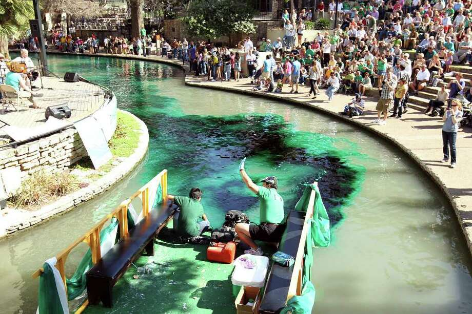 About 110 pounds of environmentally friendly green dye is sprayed into the river to kick off the St. Patrick's Day Festival. Photo: Jennifer Whitney/Special To The Express-News / special to the Express-News