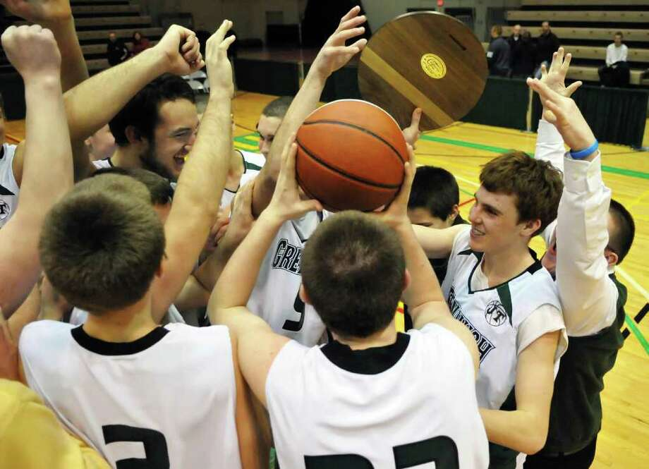 Greenwich team mates celebrate beating Brushton-Moira in the Class C regionals at HVCC in Troy Saturday night March 12, 2011.   (John Carl D'Annibale / Times Union) Photo: John Carl D'Annibale / 00012371A