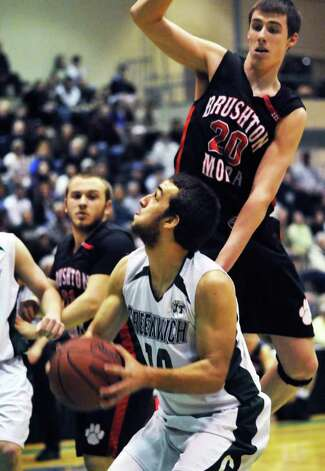 Greenwich's #10 Ryan McFee gts under Brushton-Moira's #20 Adrian Martin in the Class C regionals at HVCC in Troy Saturday night March 12, 2011.   (John Carl D'Annibale / Times Union) Photo: John Carl D'Annibale / 00012371A