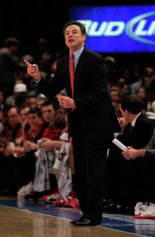 NEW YORK, NY - MARCH 12: Head coach Rick Pitino of the Louisville Cardinals reacts from the bench during the game against the Connecticut Huskies during the championship of the 2011 Big East Men's Basketball Tournament presented by American Eagle Outfitters at Madison Square Garden on March 12, 2011 in New York City.  (Photo by Chris Trotman/Getty Images) *** Local Caption *** Rick Pitino Photo: Chris Trotman, Getty Images / 2011 Getty Images