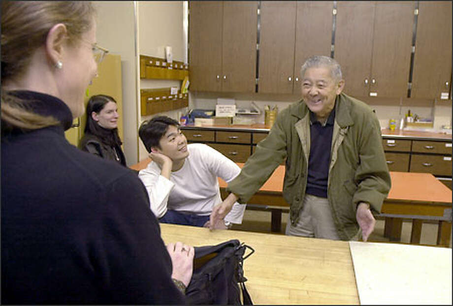 George Morihiro, right, a World War II veteran of the 442nd Regimental Combat Team, shares a laugh with Nora Ludden, left; screenwriter M.C. Schuler, foreground; and Tony Nam at the Nisei Veterans Hall in Seattle. Photo: Ron Wurzer/Seattle Post-Intelligencer