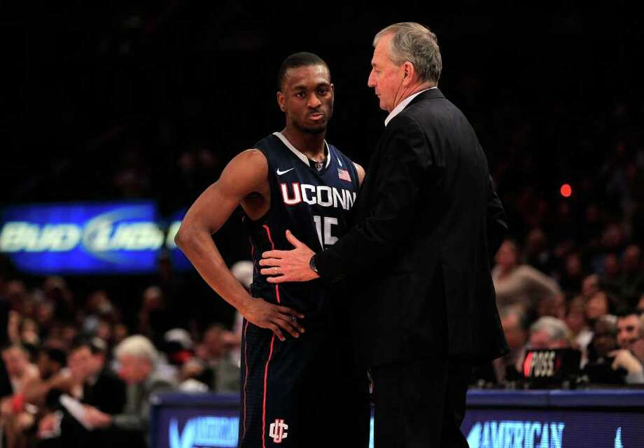 NEW YORK, NY - MARCH 12: Kemba Walker #15 of the Connecticut Huskies speaks with head coach Jim Calhoun during the championship of the 2011 Big East Men's Basketball Tournament presented by American Eagle Outfitters at Madison Square Garden on March 12, 2011 in New York City.  (Photo by Chris Trotman/Getty Images) *** Local Caption *** Kemba Walker;Jim Calhoun Photo: Chris Trotman, Getty Images / 2011 Getty Images