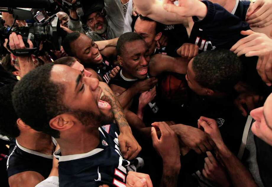 NEW YORK, NY - MARCH 12: Kemba Walker #15 of the Connecticut Huskies celebrates with teammates after defeating the Louisville Cardinals during the championship of the 2011 Big East Men's Basketball Tournament presented by American Eagle Outfitters at Madison Square Garden on March 12, 2011 in New York City.  (Photo by Chris Trotman/Getty Images) *** Local Caption *** Kemba Walker Photo: Chris Trotman, Getty Images / 2011 Getty Images