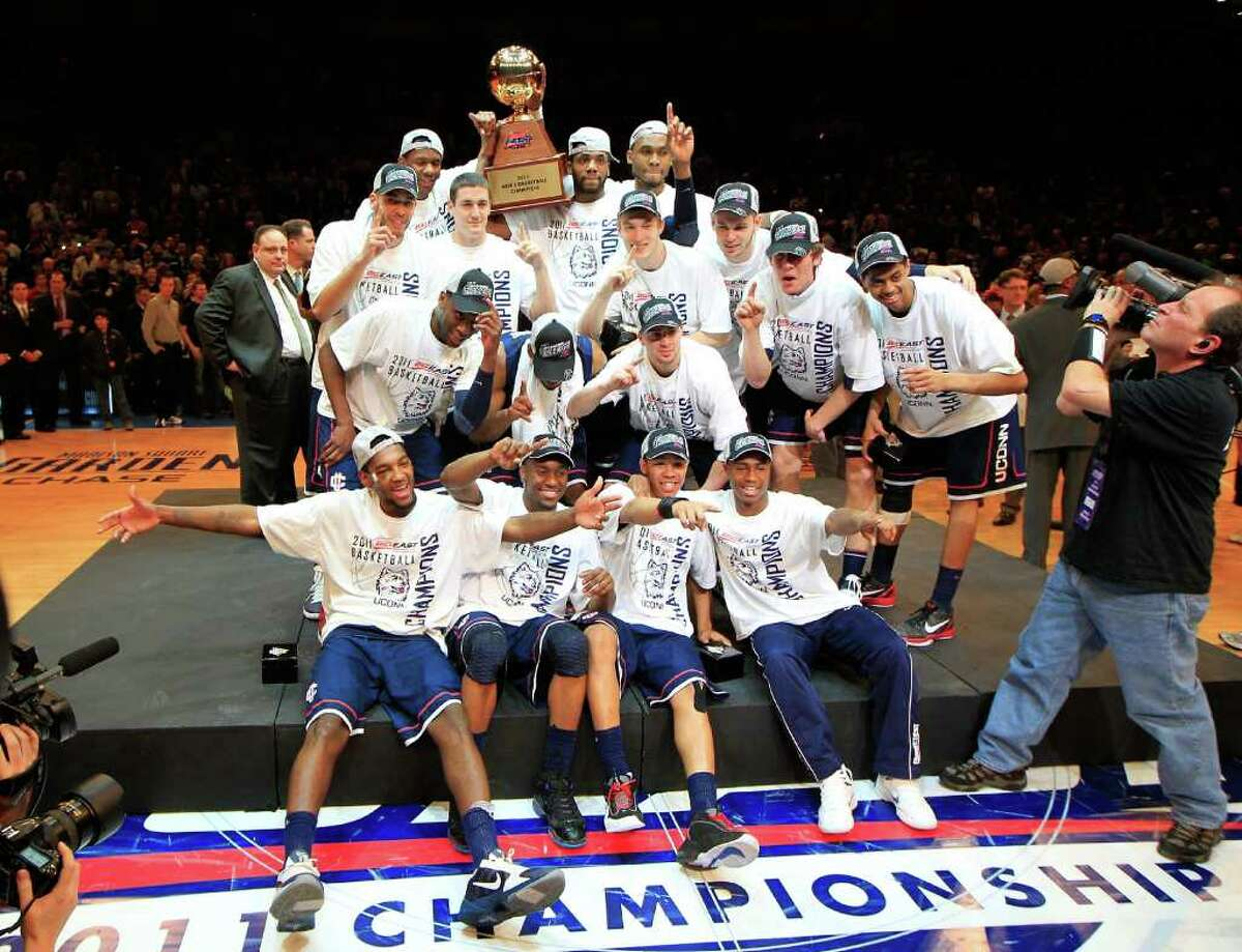 NEW YORK, NY - MARCH 12: The Connecticut Huskies celebrate with their trophy after defeating the Louisville Cardinals during the championship of the 2011 Big East Men's Basketball Tournament presented by American Eagle Outfitters at Madison Square Garden on March 12, 2011 in New York City. (Photo by Chris Trotman/Getty Images)