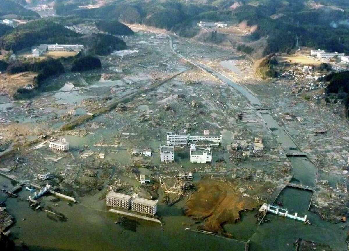 Minamisanriku town is submerged after Friday's strong earthquake-triggered tsunami in Miyagi prefecture, northern Japan, Saturday, March 12, 2011. (AP Photo/Kyodo News) MANDATORY CREDIT, NO LICENSING ALLOWED IN CHINA, HONG KONG, JAPAN, SOUTH KOREA AND FRANCE