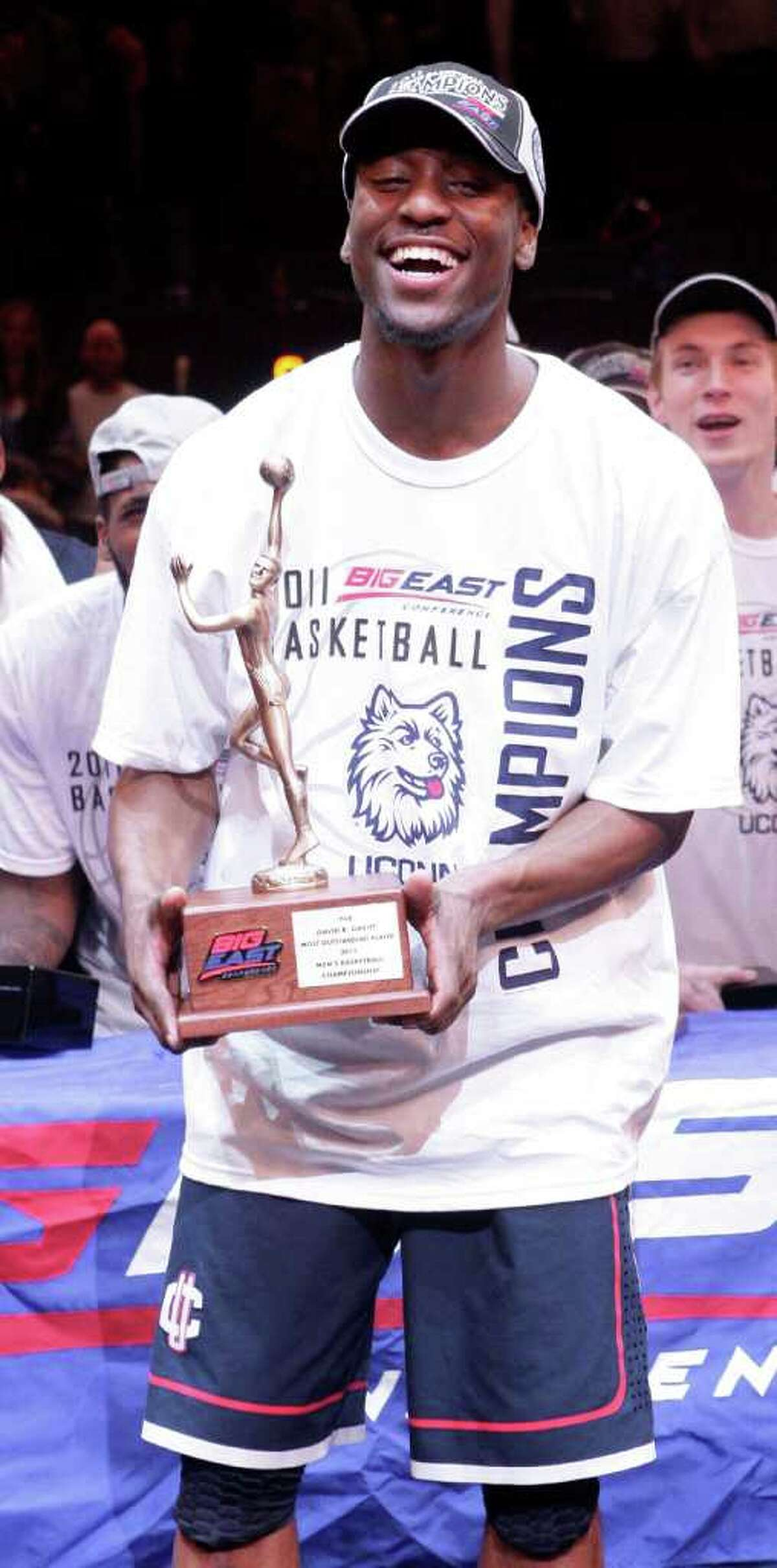 Connecticut's Kemba Walker (15) holds the Most Outstanding player trophy after an NCAA college basketball game against Louisville at the Big East Championship Saturday, March 12, 2011, in New York. Connecticut won the game 69-66. (AP Photo/Frank Franklin II)
