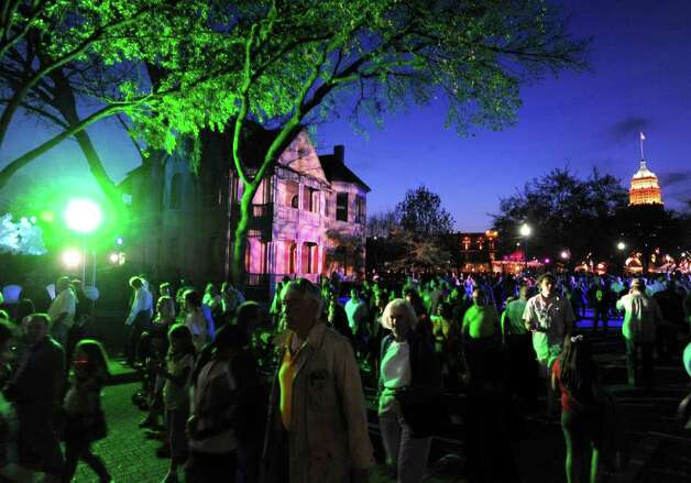 People walk in HemisFair Park during Luminaria on Saturday, March 12, 2011. Photo: Billy Calzada/Express-News / gcalzada@express-news.net