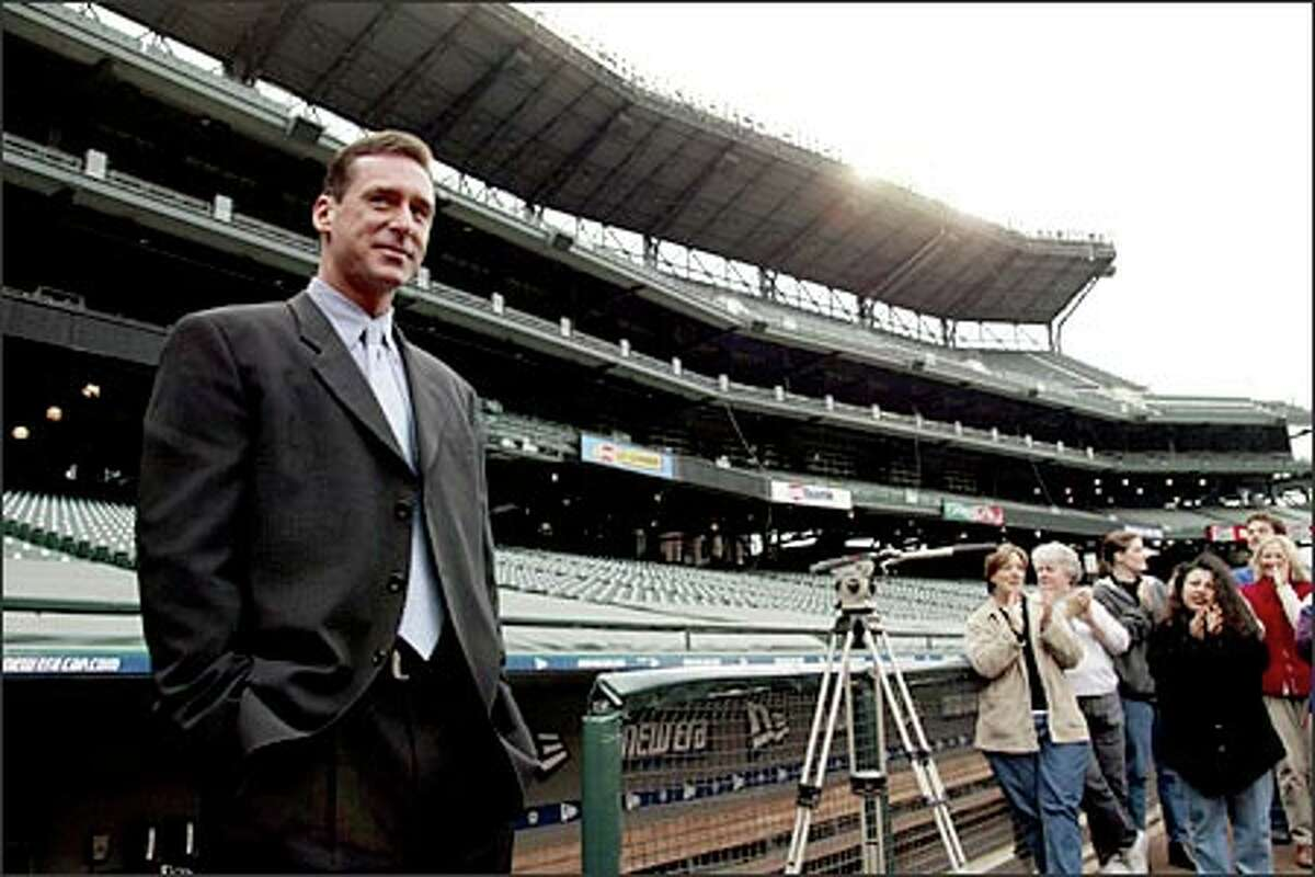 Team employees applaud Bob Melvin yesterday at Safeco Field as he checks out his new home on his first day as Mariners manager.
