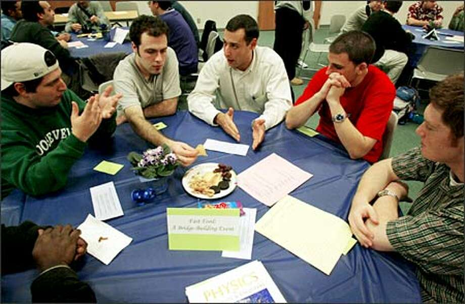 "Erick Barron, Auran Eisner, Boulos Bichay, Donovan Marley and Ilan Maizlin gather for their ""Fast Food"" dinner in the Husky Union Building at the UW. Photo: Paul Joseph Brown/Seattle Post-Intelligencer"