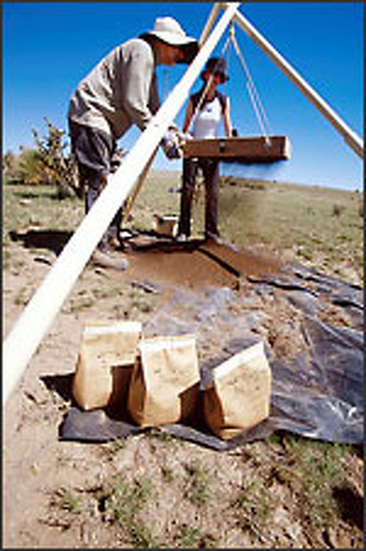 Bags of materials excavated from the supposed site of a UFO crash in Roswell, N.M., will be kept in a bank vault until they can be extensively examined in a lab.