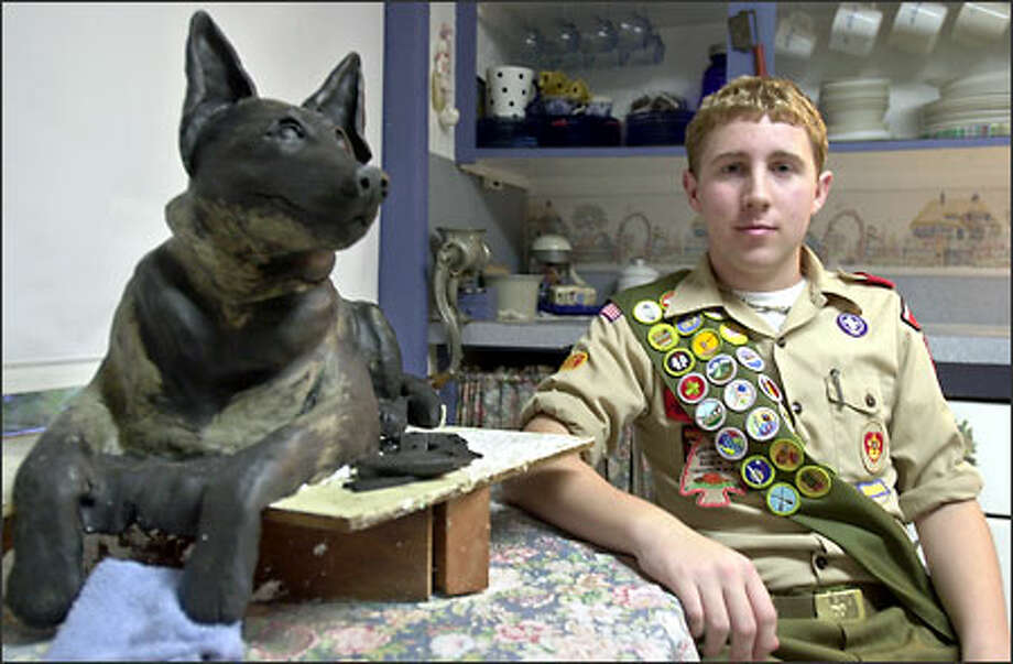 Zach Adam, 17, sculpted this clay statue of a police dog which is being cast into bronze for display at the Criminal Justice Training Center in Burien. Photo: Ron Wurzer/Seattle Post-Intelligencer