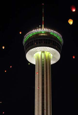 Some of the 300 Taiwanese paper lanterns float past the Tower of the Americas during Luminaria 2011 on Saturday, March 12, 2011, in HemisFair Park. Photo: EDWARD A. ORNELAS, Edward A. Ornelas/Express-News / SAN ANTONIO EXPRESS-NEWS NFS
