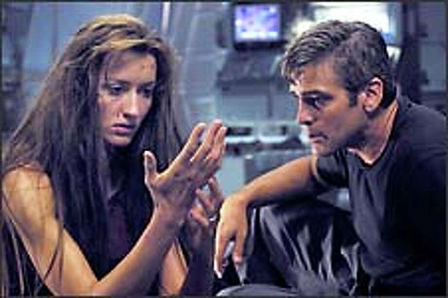 Chris Kelvin (George Clooney) has a shocking reunion with his beloved but long dead wife Rheya (Natascha McElhone). Photo: Bob Marshak