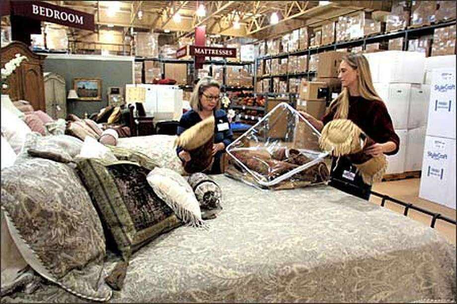 Jan Carlson  left  of Costco Home s sales staff  and Kristen Sauer  a. Costco embraces high end goods for  Home  store   seattlepi com