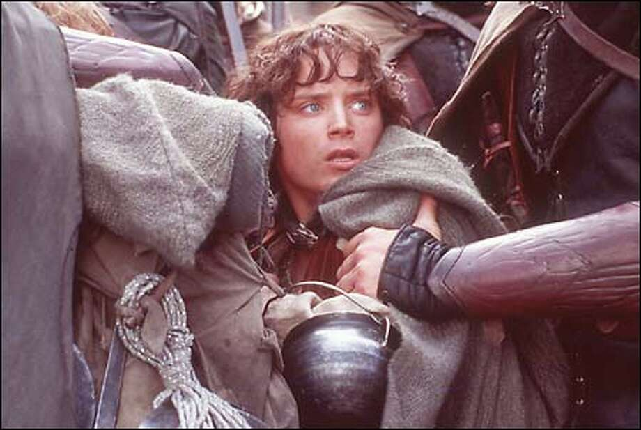 "This still shows Frodo (Elijah Wood) continues on perilous quest through Middle Earth in ""The Lord of the Rings"" film series. Photo: / New Line Cinema"