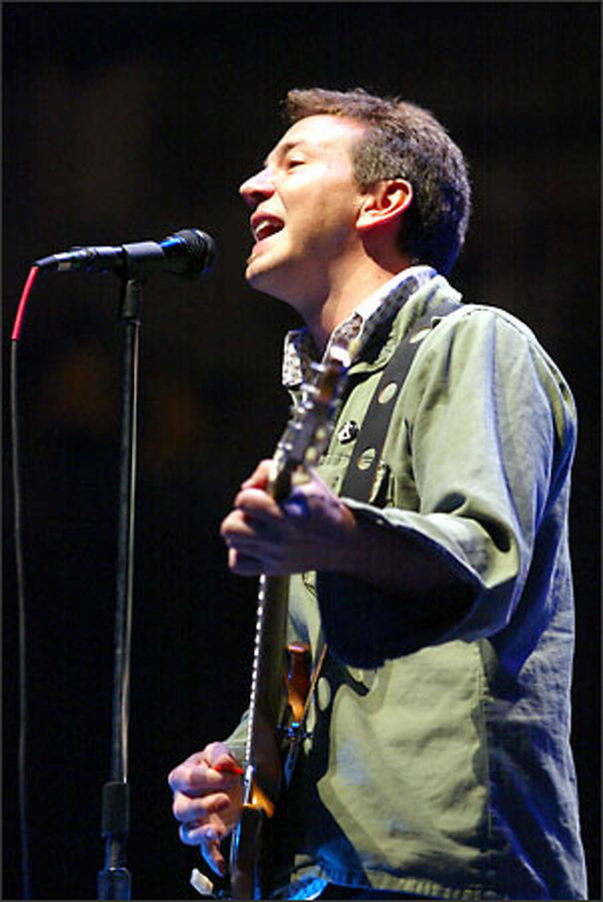 Pearl Jam lead singer Eddie Vedder opens the first of two sold-out shows at Key Arena. The shows benefit a diverse group of local and national non-profits. The band expects to raise $400,000. Since 1993 Pearl Jam has raised more than $1.2 million for non-profits through benefit concerts.