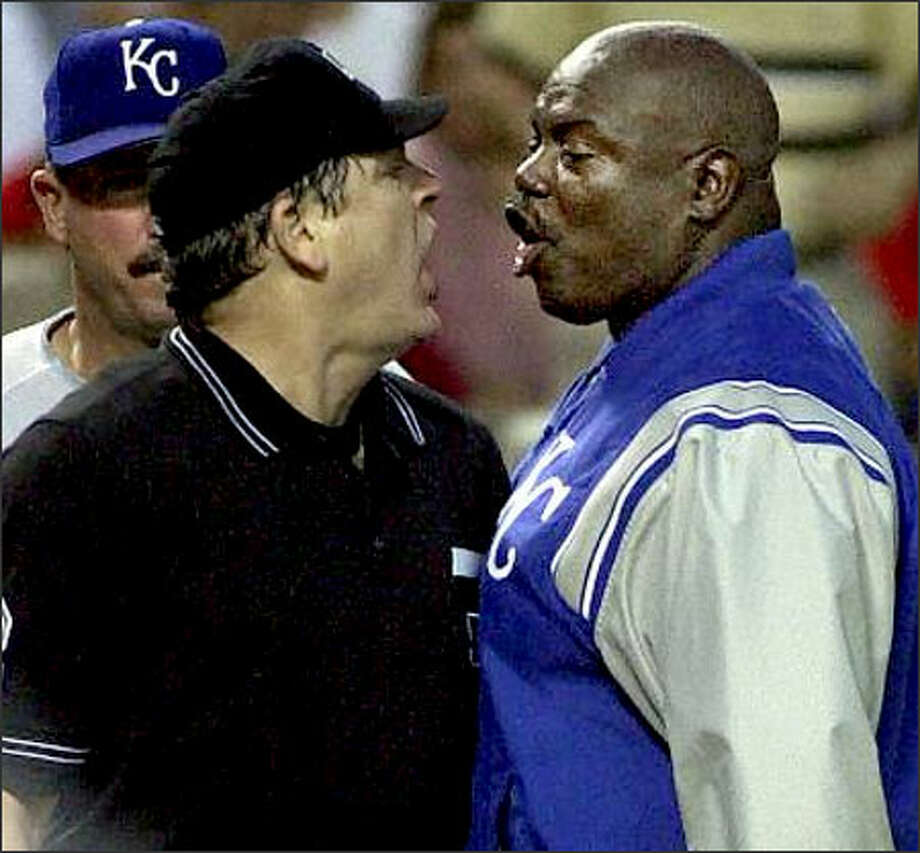 Lamar Johnson, then a Kansas City coach, argues with an umpire during a game in May 2001.  He was ejected. Photo: / Associated Press
