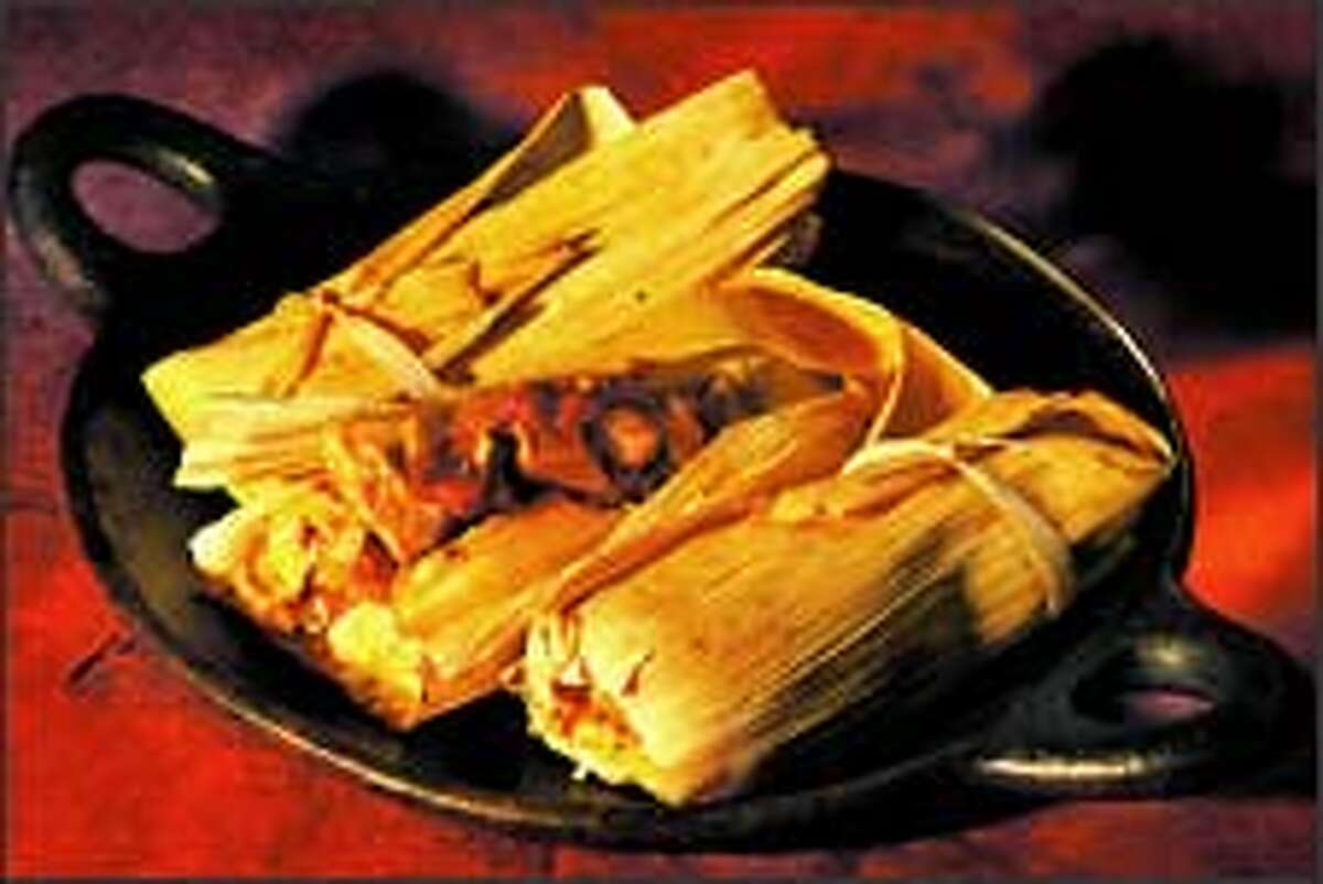 Family Chicken Tamales can be tied up with a strip of the corn husk. Shaping the tamales is less tricky than it seems. For the recipe, see below.