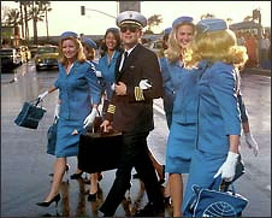 "Frank Abagnale Jr. (Leonardo DiCaprio) passes himself off as a Pan Am pilot, shown here surrounded by flight attendants, in ""Catch Me If You Can."""