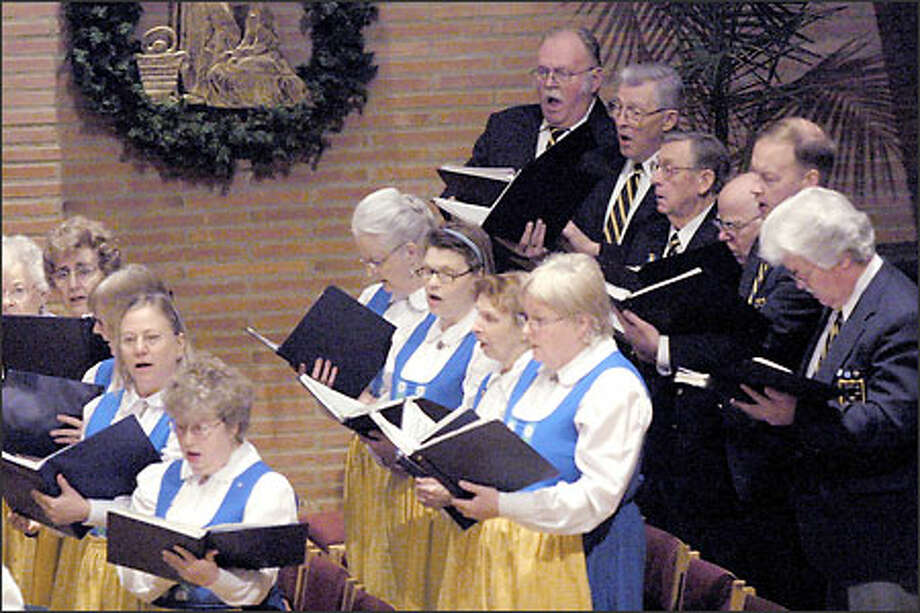 Members of the Swedish Women's Chorus and the Svea Male Chorus sing during the Christmas Day service. Photo: Phil H. Webber/Seattle Post-Intelligencer