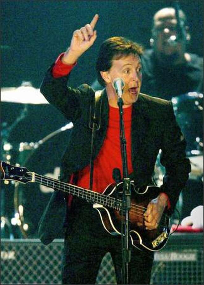 Paul McCartney rocks at the Tacoma Dome Saturday night during his concert tour to a capacity crowd. Photo: Renee C. Byer/Seattle Post-Intelligencer