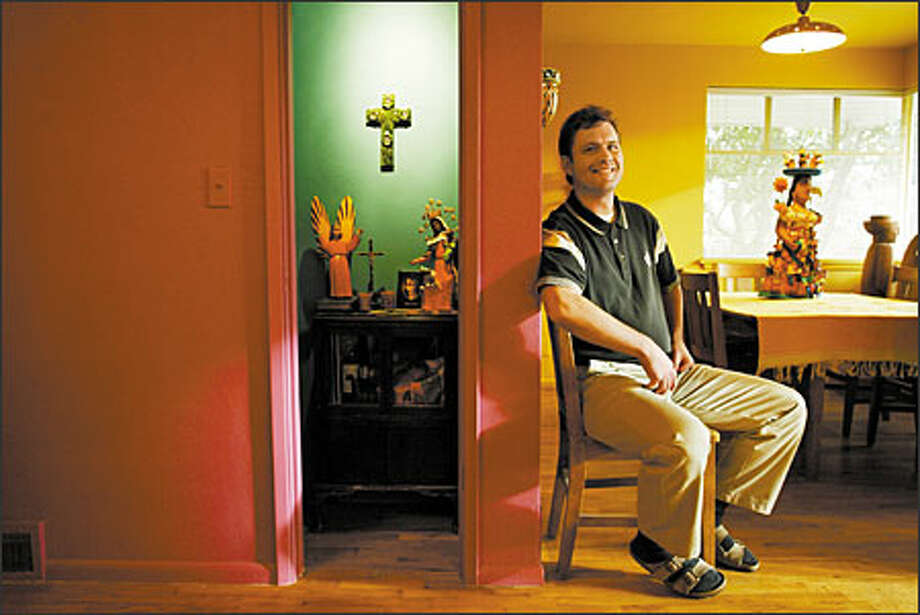 Seattle chef Stuart Miller's love for Mexico is reflected in his folk art collection and vivid walls, which are painted magenta, plum, aquamarine, gold, palm green and azul anil. Photo: Paul Joseph Brown/Seattle Post-Intelligencer