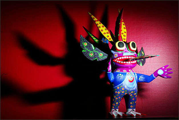 A carved, wooden alebrije (protector) made by Mexican artist Luis Sosa in Maria Barrientos' collection. Photo: Mike Urban/Seattle Post-Intelligencer