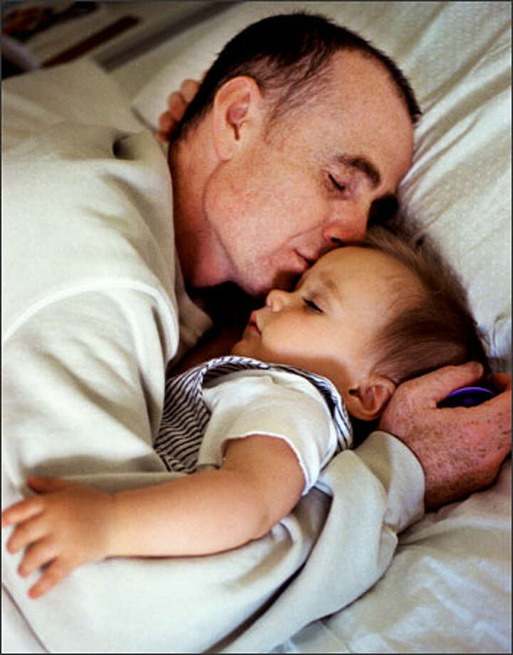Father and son: Thomas Soukakos, whose wife committed suicide from postpartum depression, naps with his son Alexander, then 10 months old. The two shared a room until after Alexander's first birthday. - The story in pictures: See more images in the photo gallery. Photo: Renee C. Byer/Seattle Post-Intelligencer