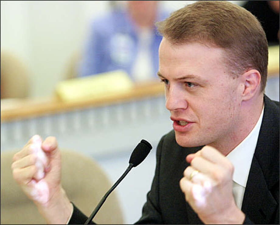 Initiative leader Tim Eyman urges legislators at the Capitol to allow smaller petition sheets to save money and time. He has been sponsoring initiatives for more than 20 years, but faces a $1.9 million civil suit by the Attorney General's office for kickbacks and money laundering. Photo: / Associated Press