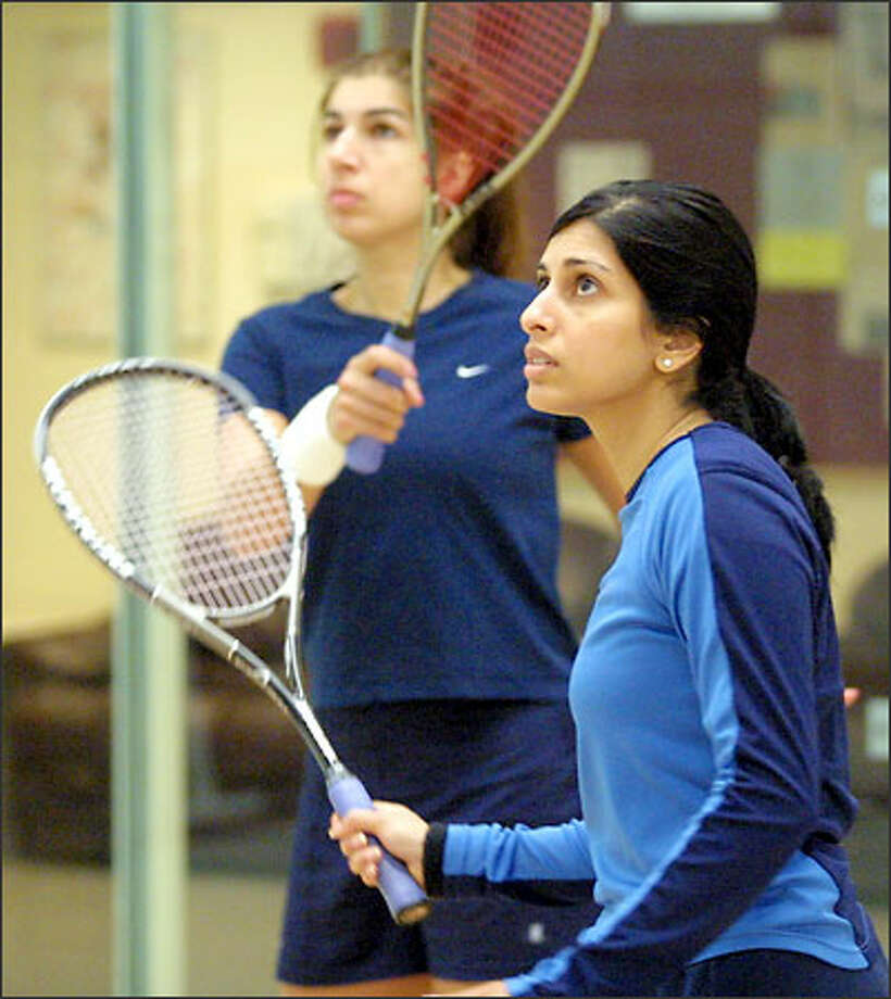 Latasha Khan, left, is the current national squash champion and has held the title three times. Older sister Shabana won the national title in 2001, beating Latasha in the final. Photo: Phil H. Webber/Seattle Post-Intelligencer