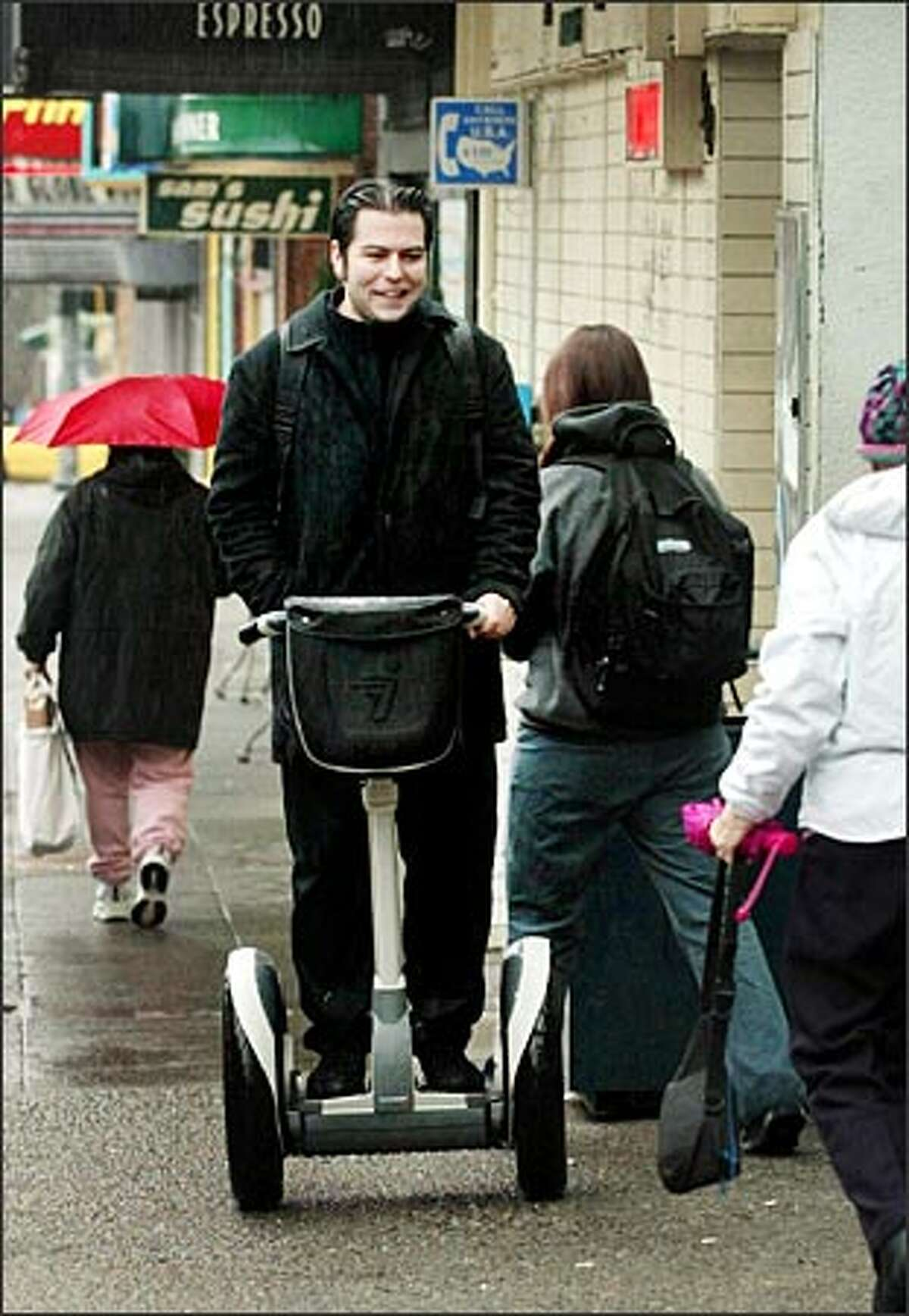Phillip Torrone rides his Segway Human Transporter to work on Lower Queen Anne.