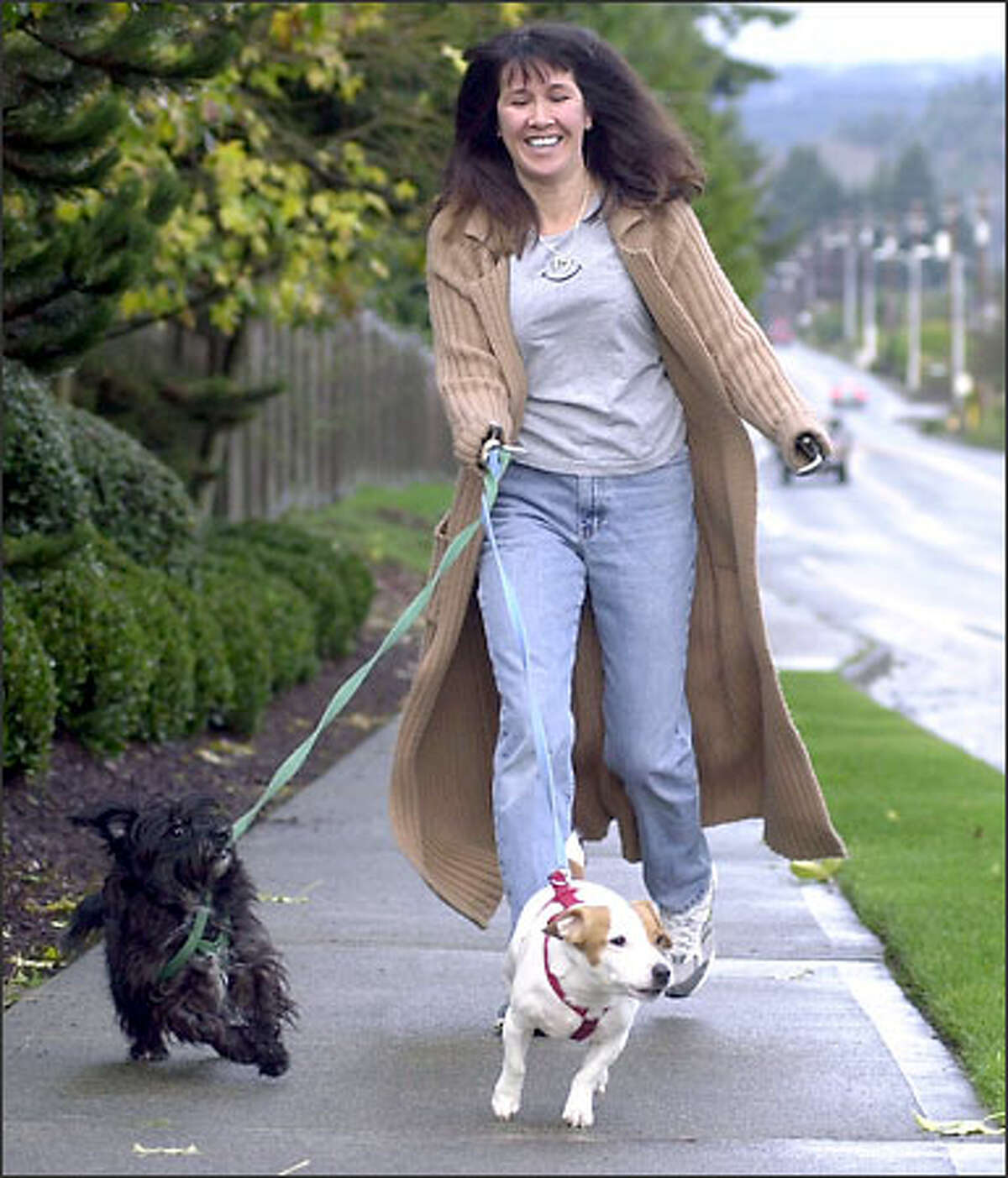 Vincent walks her two dogs, Danny, left, and Mikey. Vincent and her two sons also have hamsters, fish and an ill-tempered parrot.