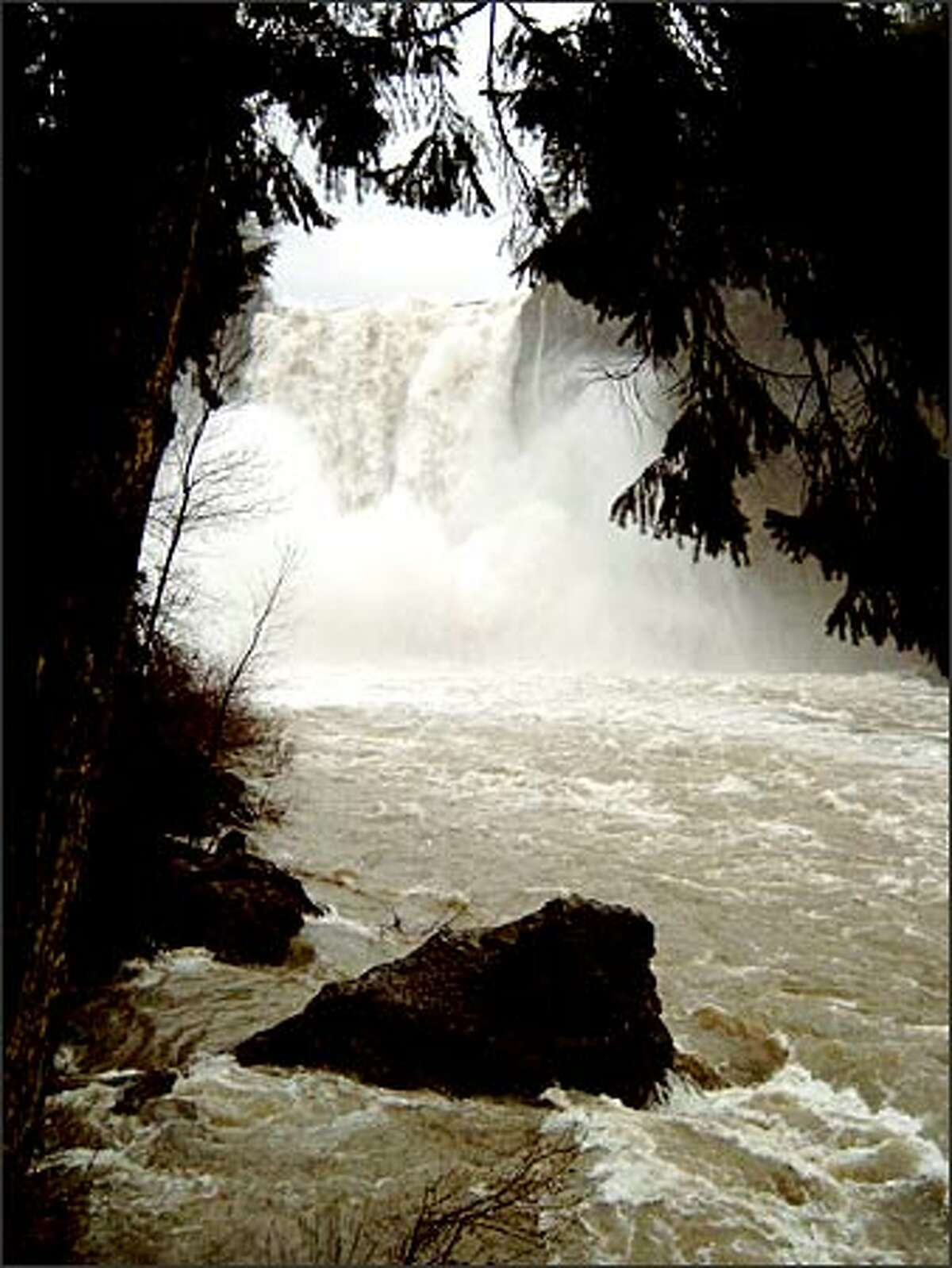 The spirituality felt by Native Americans at Snoqualmie Falls is palpable after a heavy rain.