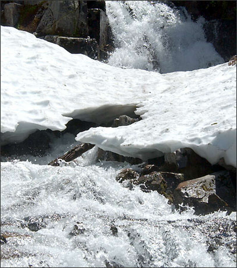 Ninety of 145 sites in the Cascade and Olympic mountains studied over a 42-year period showed declines of water content in snow of 25 percent or more. Photo: Jeff Larsen/Seattle Post-Intelligencer