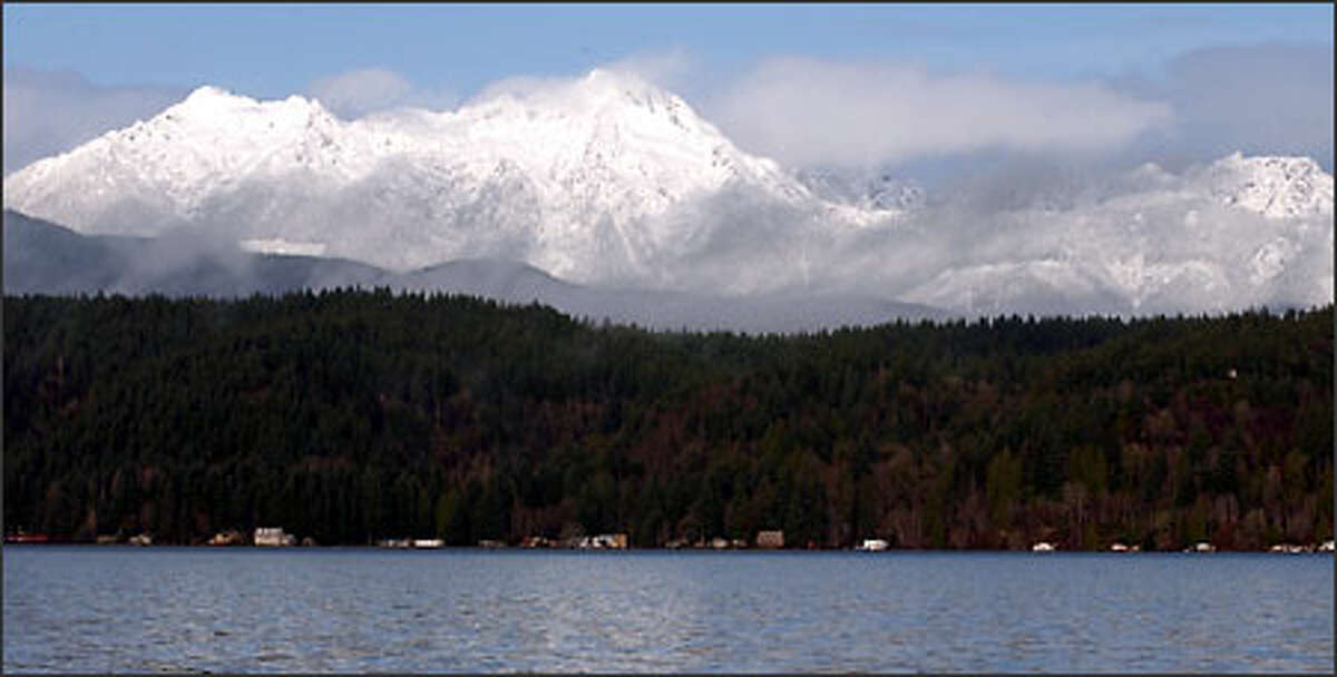 Late December snowfall blankets the Olympic Mountains. Hood Canal is in the foreground.